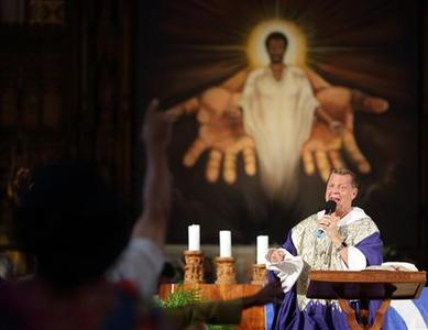 Rev. Michael Pfleger delivers his sermon at St. Sabina Catholic Church during the predominantly African-American congregation's Unity Mass in Chicago, September 2, 2012. A Reuters/Ipsos Poll conducted last weekend reveals the divergent opinions in the Church and shows that Catholics are divided equally between Democratic President Barack Obama and Republican challenger Mitt Romney, with each winning just under 40 percent of voters. Picture taken September, 2, 2012. REUTERS/John Gress