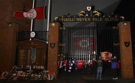 Tributes are seen on the gates at Anfield stadium in Liverpool, northern England September 12, 2012. REUTERS/Nigel Roddis