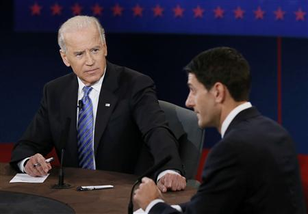 Vice President Joe Biden (L) listens as Republican vice-presidential nominee Paul Ryan speaks during the vice presidential debate in Danville, Kentucky, October 11, 2012. REUTERS/Rick Wilking