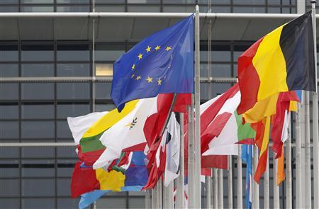 The European flag (top L) flies amongst EU member countries' national flags in front of the European Parliament in Strasbourg October 12, 2012. REUTERS/Vincent Kessler