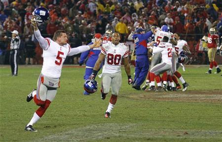 New York Giants holder Steve Weatherford (5) celebrates with teammates including Victor Cruz (80) after the Giants defeated the San Francisco 49ers in overtime in the NFL NFC Championship game in San Francisco, California, January 22, 2012. REUTERS/Beck Difenbach