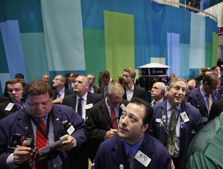 Traders gather for the first trades of Workday Inc. on the floor of the New York Stock Exchange, October 12, 2012. REUTERS/Brendan McDermid