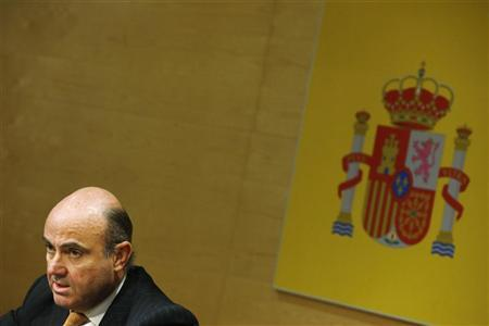 Spanish Economy Minister Luis de Guindos attends a news conference with European Economic and Monetary Affairs Commissioner Olli Rehn (not pictured) in Madrid October 1, 2012. REUTERS/Susana Vera