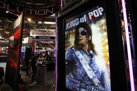 A portrait of the late pop star Michael Jackson is displayed on a slot machine at Gaming Expo Asia in Macau May 22, 2012. REUTERS/Bobby Yip