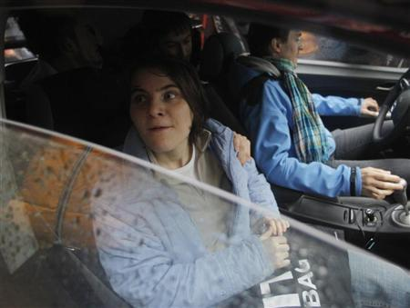 Yekaterina Samutsevich, a member of the female punk band ''Pussy Riot'', sits in a car after she was freed from the courtroom in Moscow October 10, 2012. REUTERS/Maxim Shemetov