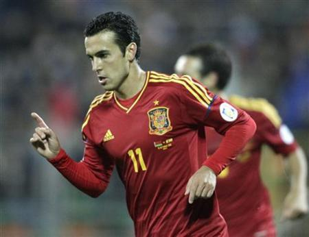 Spain's Pedro celebrates his goal against Belarus during their 2014 World Cup qualifying soccer match in Minsk October 12, 2012. REUTERS/Vasily Fedosenko