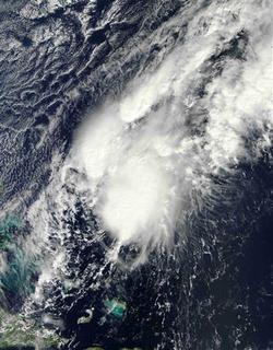 Tropical Storm Patty is pictured in the Atlantic Ocean, 230 miles (375 km) east-northeast of the Bahamas in this October 11, 2012 NASA handout satellite image obtained by Reuters October 12. Forecasters expect the storm to move south-southeast and weaken over the next few days. REUTERS/NASA/Handout
