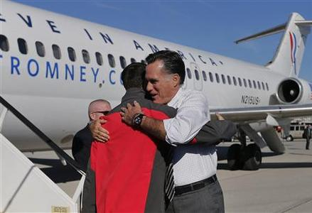 Republican presidential nominee Mitt Romney greets vice presidential nominee Paul Ryan after arriving in Columbus, Ohio October 12, 2012. REUTERS/Shannon Stapleton