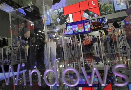 The Windows 8 operating system is displayed at the Microsoft booth during the 2012 Computex exhibition at the TWTC Nangang exhibition hall in Taipei June 6, 2012. Computex, the world's second largest show, runs from June 5 to 9. REUTERS/Yi-ting Chung