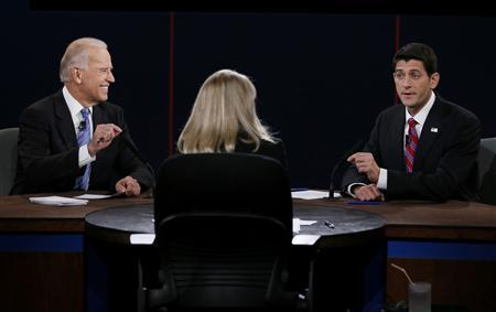 U.S. Vice President Joe Biden (L) and Republican vice presidential nominee Paul Ryan (R) debate in front of moderator Martha Raddatz (C) during the vice presidential debate in Danville, Kentucky October 11, 2012. REUTERS/Kevin Lamarque
