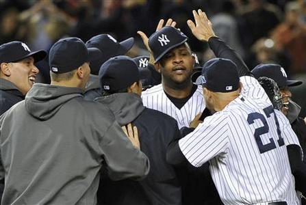 New York Yankees starting pitcher CC Sabathia (C) celebrates with teammates, including Raul Ibanez (27), after the Yankees defeated the Baltimore Orioles in Game 5 of their MLB ALDS baseball playoff series in New York, October 12, 2012. REUTERS/Ray Stubblebine