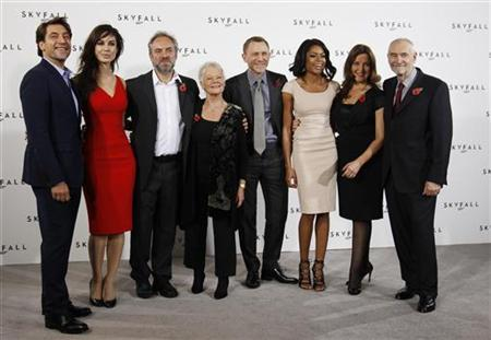 Director Sam Mendes (3rd L) poses with cast members (L-R) Javier Bardem, Berenice Marlohe, Judi Dench, Daniel Craig and Naomie Harris along with producers Barbara Broccoli and Michael G. Wilson during a photocall to launch the start of production of the new James Bond film ''SkyFall'' at a restaurant in London November 3, 2011. REUTERS/Luke MacGregor