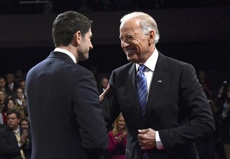 U.S. Vice President Joe Biden (R) and Republican vice presidential nominee Paul Ryan shake hands at the conclusion of the vice presidential debate in Danville, Kentucky October 11, 2012. REUTERS/Pool