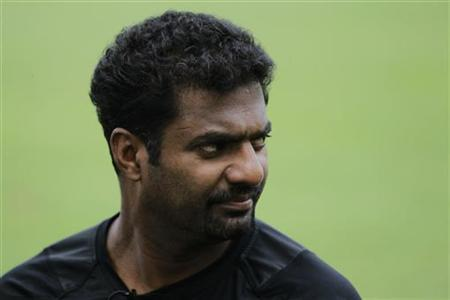 Sri Lankan cricketer Muttiah Muralitharan looks on during an interview with media at Singapore Cricket Club October 13, 2012. REUTERS/Tim Chong