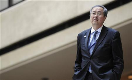 China's Central Bank Governor Zhou Xiaochuan arrives for a group photo taking session with other REUTERS/Jonathan Ernst