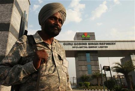 An Indian security personnel stands guard in front of the main entrance of the Guru Gobind Singh oil refinery near Bhatinda in Punjab April 27, 2012. The refinery has been built in joint venture collaboration with Mittal Energy, owned by steel tycoon Lakshmi Mittal, and state-run Hindustan Petroleum Corporation Limited (HPCL). REUTERS/Ajay Verma/Files