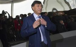 The chairman of ArcelorMittal Lakshmi Mittal poses for a photograph at the top of the ArcelorMittal Orbit in the London 2012 Olympic Park in east London May 11, 2012. REUTERS/Ki Price