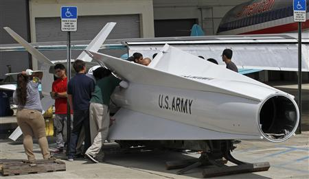 Miami area high school students at the George T. Baker Aviation school prepare to attach ailerons to a 41-foot surface-to-air Nike Hercules missile as they restore it at the school in Miami, Florida October 10, 2012. REUTERS-Joe Skipper