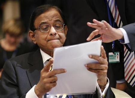 India's Finance Minister Palaniappan Chidambaram reads a documents prior to the International Monetary and Financial Committee at the annual meetings of the IMF and the World Bank Group in Tokyo October 13, 2012. REUTERS/Kim Kyung-Hoon