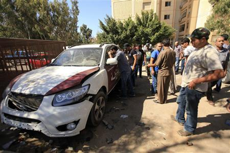 A car belonging to Colonel Mohammed Ben Haleem is seen after it exploded in Benghazi October 13, 2012. A police car exploded on Saturday during a failed assassination attempt on a police colonel in the eastern city of Benghazi, a Libyan police official said. REUTERS/Esam Al-Fetori