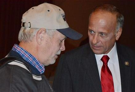 Rep. Steve King (R) speaks to R. Doc Zortman after a debate against opponent Christie Vilsack in Sioux City, Iowa October 9, 2012. REUTERS/Nick Carey