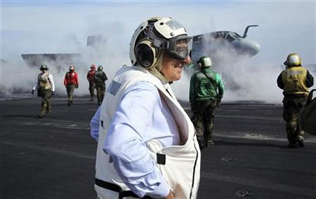 U.S. Defense Secretary Leon Panetta watches day flight operations from the flight deck of the aircraft carrier USS Enterprise, off the coast of the U.S. state of Georgia, January 21, 2012. REUTERS/Alex Wong/Pool
