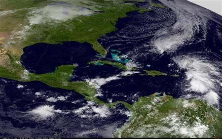 Tropical Storm Rafael is seen churning the eastern Caribbean Sea in this NASA handout satellite image taken on October 13, 2012. REUTERS/NASA/NOAA/GOES Project/Handout