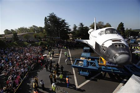 The Space Shuttle Endeavour is moved to the California Science Center in Los Angeles October 13, 2012. REUTERS/Mario Anzuoni