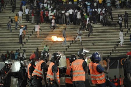 Senegalese football fans throw rocks at the police at Leopold Sedar Senghor stadium in Dakar October 13, 2012. REUTERS/Mamadou Gomis