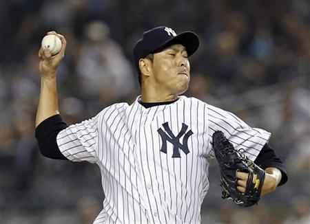 New York Yankees starting pitcher Hiroki Kuroda pitches against the Boston Red Sox during the first inning of their MLB American League baseball game at Yankee Stadium in New York, October 3, 2012. REUTERS/Adam Hunger