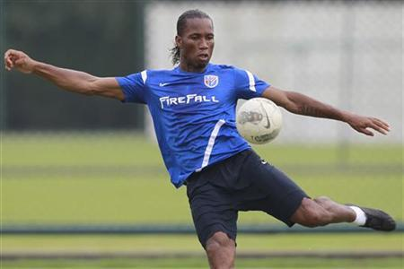 Didier Drogba of Ivory Coast kicks a ball during a training session in Shanghai July 16, 2012. REUTERS/Aly Song/Files