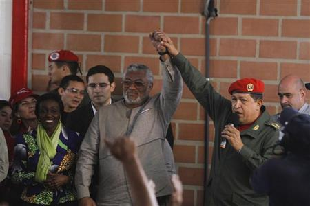 Venezuela's President Hugo Chavez (R), former Ghanaian President Jerry Rawlings (C) and his wife, Nana Konadu Agyeman-Rawlings, visit a homeless shelter in the low-income neighborhood of Gramoven in Caracas December 2, 2010. REUTERS/Miraflores Palace/Handout