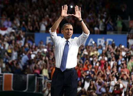 U.S. President Barack Obama greets students before he speaks in the BankUnited Center at the University of Miami in Coral Gables, Florida, October 11, 2012. REUTERS/Larry Downing