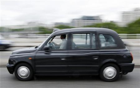 A London taxi crosses Waterloo Bridge in London July 29, 2009. REUTERS/Stephen Hird/Files