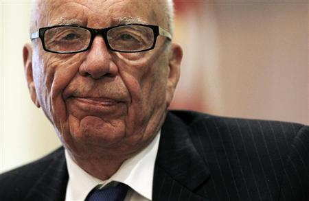 News Corp Chairman and CEO Rupert Murdoch reacts to a point as he takes part in a discussion at the ''The Economics and Politics of Immigration'' Forum in Boston, Massachusetts August 14, 2012. REUTERS/Jessica Rinaldi