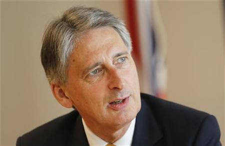 British Defence Minister Philip Hammond speaks during a news conference in Doha September 12, 2012. REUTERS/Fadi Al-Assaad