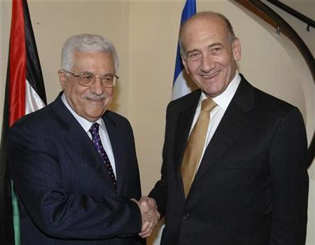 Israel's Prime Minister Ehud Olmert (R) greets Palestinian President Mahmoud Abbas during their meeting in Jerusalem September 16, 2008, in this picture released by the Israeli Government Press Office (GPO). REUTERS/Moshe Milner/GPO/Handout
