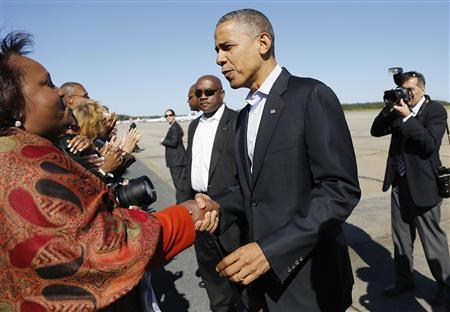 U.S. President Barack Obama greets an onlooker after disembarking from the Air Force One at Newport News/Williamsburg International Airport in Williamsburg, Virginia, October 13, 2012. REUTERS/Jonathan Ernst