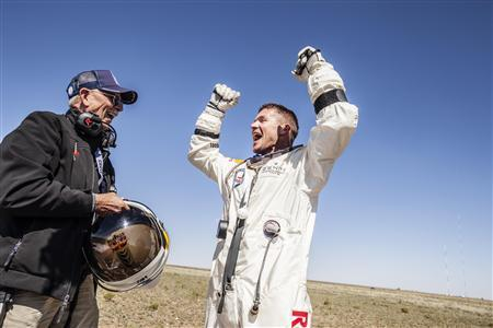 Life support engineer Mike Todd of the U.S. and pilot Felix Baumgartner of Austria celebrate after Baumgartner successfully completed the final manned flight for Red Bull Stratos in Roswell, New Mexico in this October 14, 2012 handout photo. REUTERS/Balazs Gardi/Red Bull Content Pool/Handout