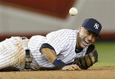 New York Yankees shortstop Derek Jeter screams as he injures himself fielding a ball hit by Detroit Tigers' Jhonny Peralta during the 12th inning of Game 1 of their MLB ALCS playoff baseball series in New York, October 13, 2012. REUTERS/Mike Segar