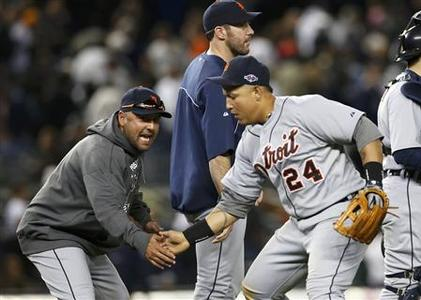 Detroit Tigers catcher Gerald Laird (L) celebrates with third baseman Miguel Cabrera as pitcher Justin Verlander (C) walks past them after the Tigers defeated the New York Yankees in Game 2 of their MLB ALCS playoff baseball series in New York, October 14, 2012. REUTERS/Mike Segar