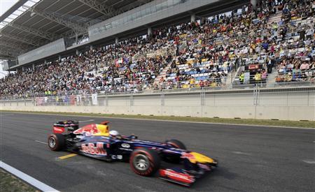 Red Bull Formula One driver Sebastian Vettel of Germany drives during the South Korean F1 Grand Prix at the Korea International Circuit in Yeongam October 14, 2012. REUTERS/Roslan Rahman/Pool