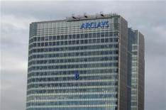 "The letter ""B"" of the signage on the Barclays headquarters in Canary Wharf is hoisted up the side of the building in London July 20, 2012. REUTERS/Simon Newman"