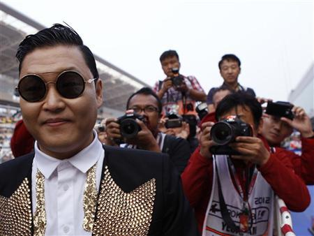 South Korea singer Psy poses for photographers before the podium ceremony of the South Korean F1 Grand Prix at the Korea International Circuit in Yeongam October 14, 2012. REUTERS/Woohae Cho