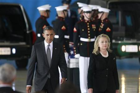 U.S. President Barack Obama and Secretary of State Hillary Clinton participate in a transfer ceremony of the remains of U.S. Ambassador to Libya, Chris Stevens and three other Americans killed this week in Benghazi, at Andrews Air Force Base near Washington, September 14, 2012. REUTERS/Jason Reed/Files
