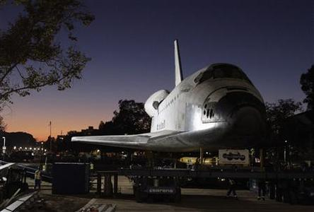 The retired Space Shuttle Endeavour is seen as it arrives at the California Science Center, in Los Angeles October 14, 2012. Endeavour rolled into its retirement home at the Center early on Sunday, in the conclusion of a slow-motion parade through the narrow streets of Los Angeles. REUTERS/Lawrence K. Ho/Los Angeles Times/Pool