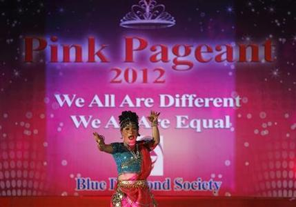 A contestant performs during the Pink Pageant, at the closing ceremony of the first South Asia Lesbian, Gay, Bisexual and Transgender (LGBT) Sports Festival in Kathmandu October 14, 2012. According to organizers, the three-day long festival was to push for LGBT rights through sports. REUTERS/Navesh Chitrakar