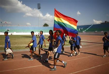 Lesbian, Gay, Bisexual, and Transgender (LGBT) players enter the field holding a rainbow flag during the opening ceremony of the first South Asia Lesbian, Gay, Bisexual and Transgender (LGBT) Sports Festival in Kathmandu, October 12, 2012. REUTERS/Navesh Chitrakar