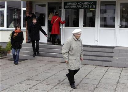 People leave a voting station during general elections in Vilnius October 14, 2012. Lithuanians are likely to eject their centre-right government in an election on Sunday that could be a taste of what awaits other European leaders forced by the financial crisis to implement unpopular austerity measures. REUTERS/Ints Kalnins