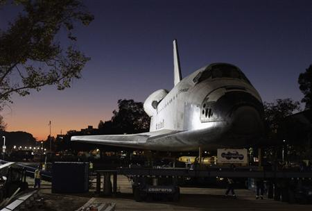 The retired Space Shuttle Endeavour is seen as it arrives at the California Science Center, in Los Angeles October 14, 2012. REUTERS/Lawrence K. Ho/Los Angeles Times/Pool